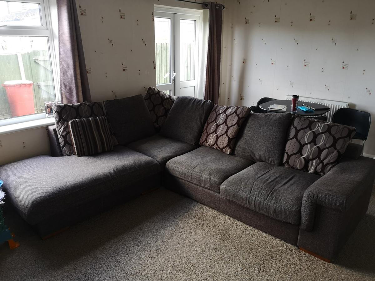 cushion back brown corner sofa. Can break down in to 3 parts for easy transportation/moving etc. UK fire retardant compliant. Purchased at Harveys 6 years ago. Clean and tidy for age with no tears or rips! Needs collecting by purchaser as new sofa coming this Monday. (17th Feb).