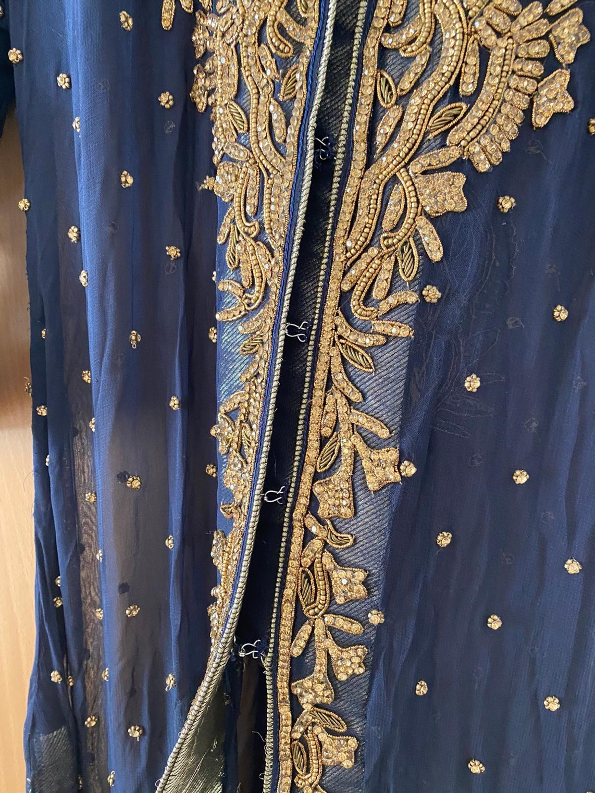 "Navy blue heavy gold embroidered full length gown jacket dress in chiffon material Length 58"" Bust 40"" Wait 35"" Side slits 29"" approximately Used once in very good condition £7 postage as it's heavy in weigh or local collect Prefer payment method by bank transfer or cash on collection RRP £250"