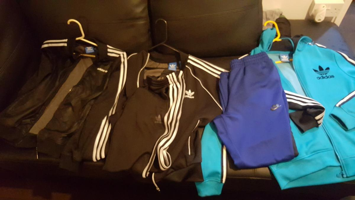 2 tops one full tracksuit one Nike bottoms size medium..mint condition worn once