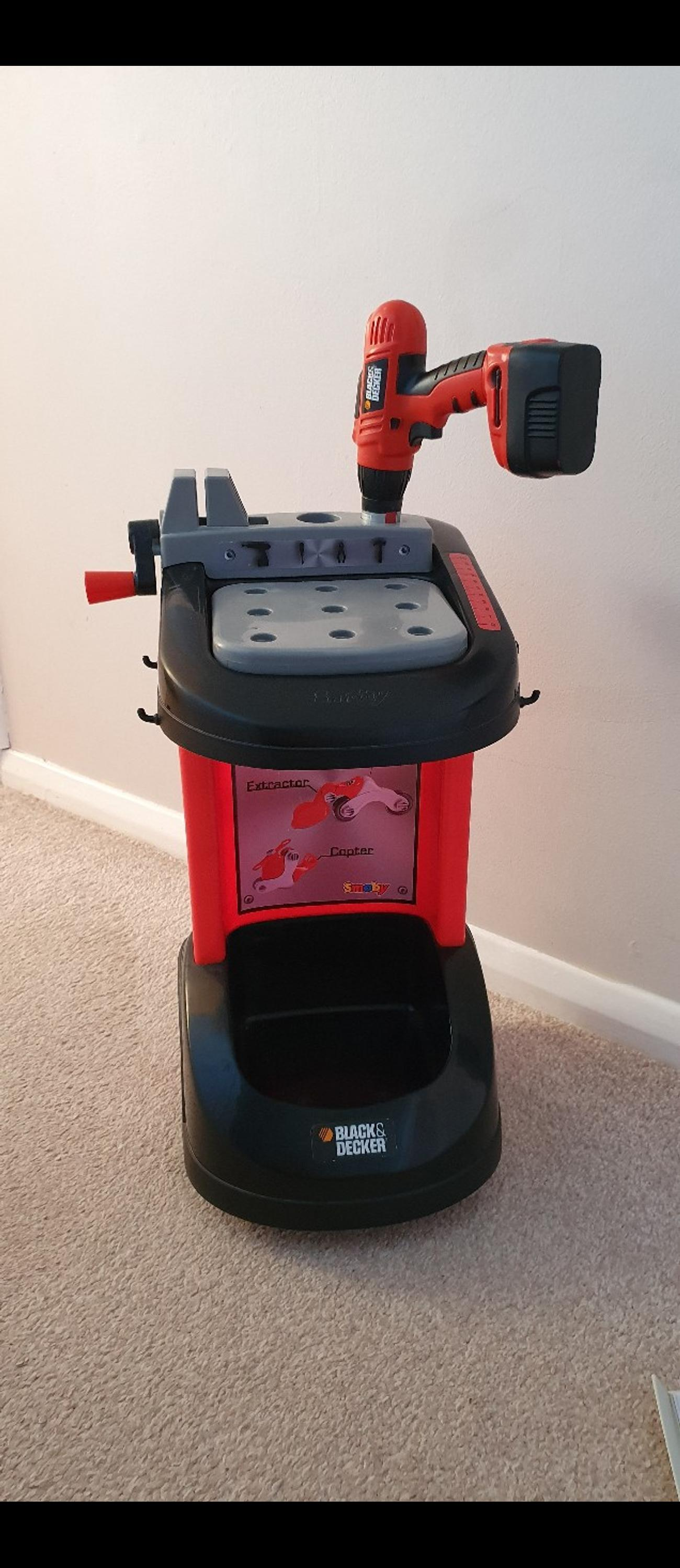 Childrens small Black and Decker work bench with tools