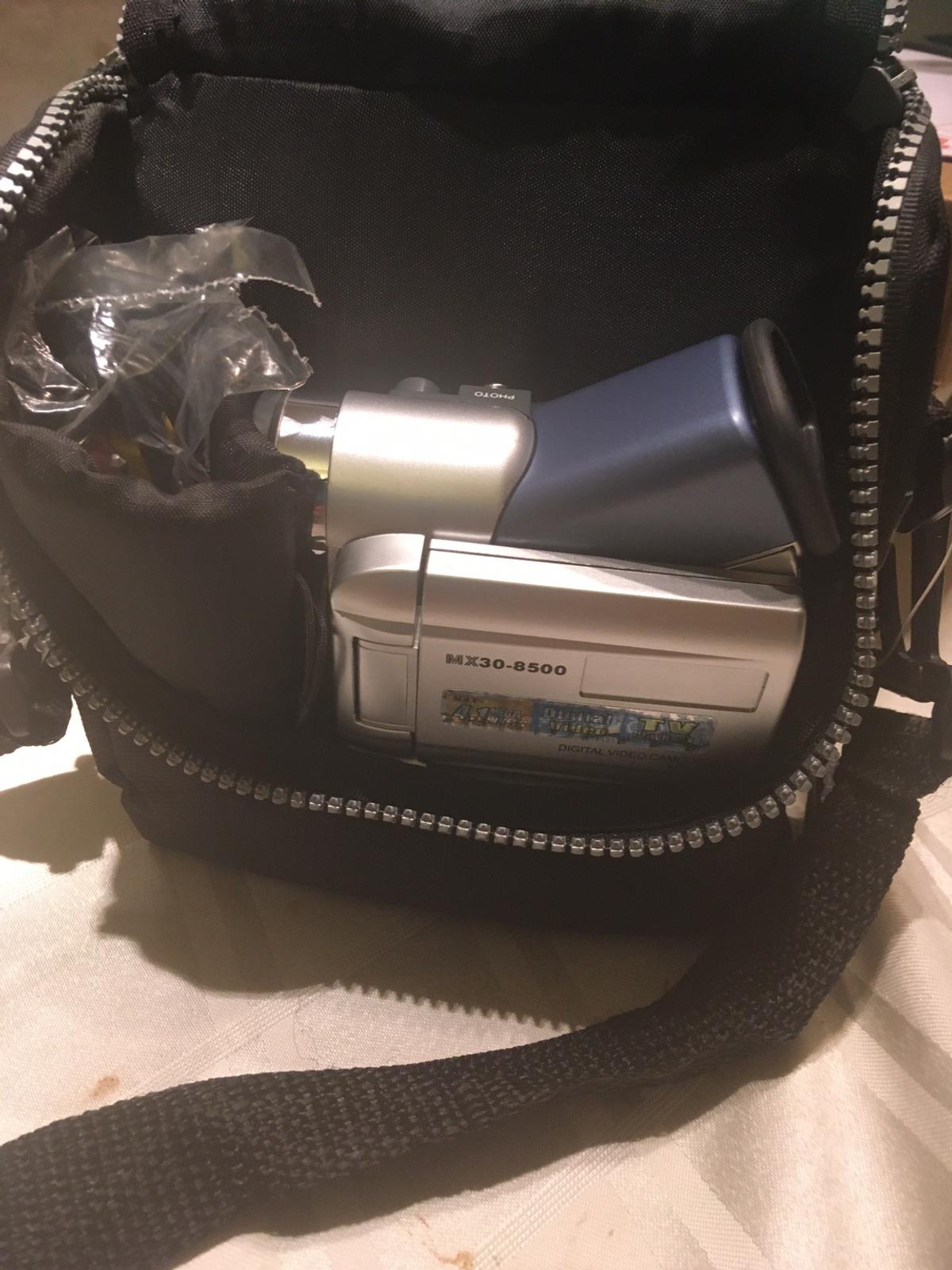 Lovely little camcorder with all accessories and 1 GB memory card included. Comes in a handy bag. Perfect for recording all occasions and taking pictures. Any questions please feel free to ask.