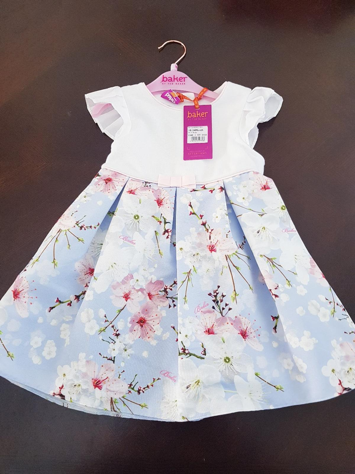 Brand New Ted baker dress. no longer needed and still has tags. Age 18-24 months