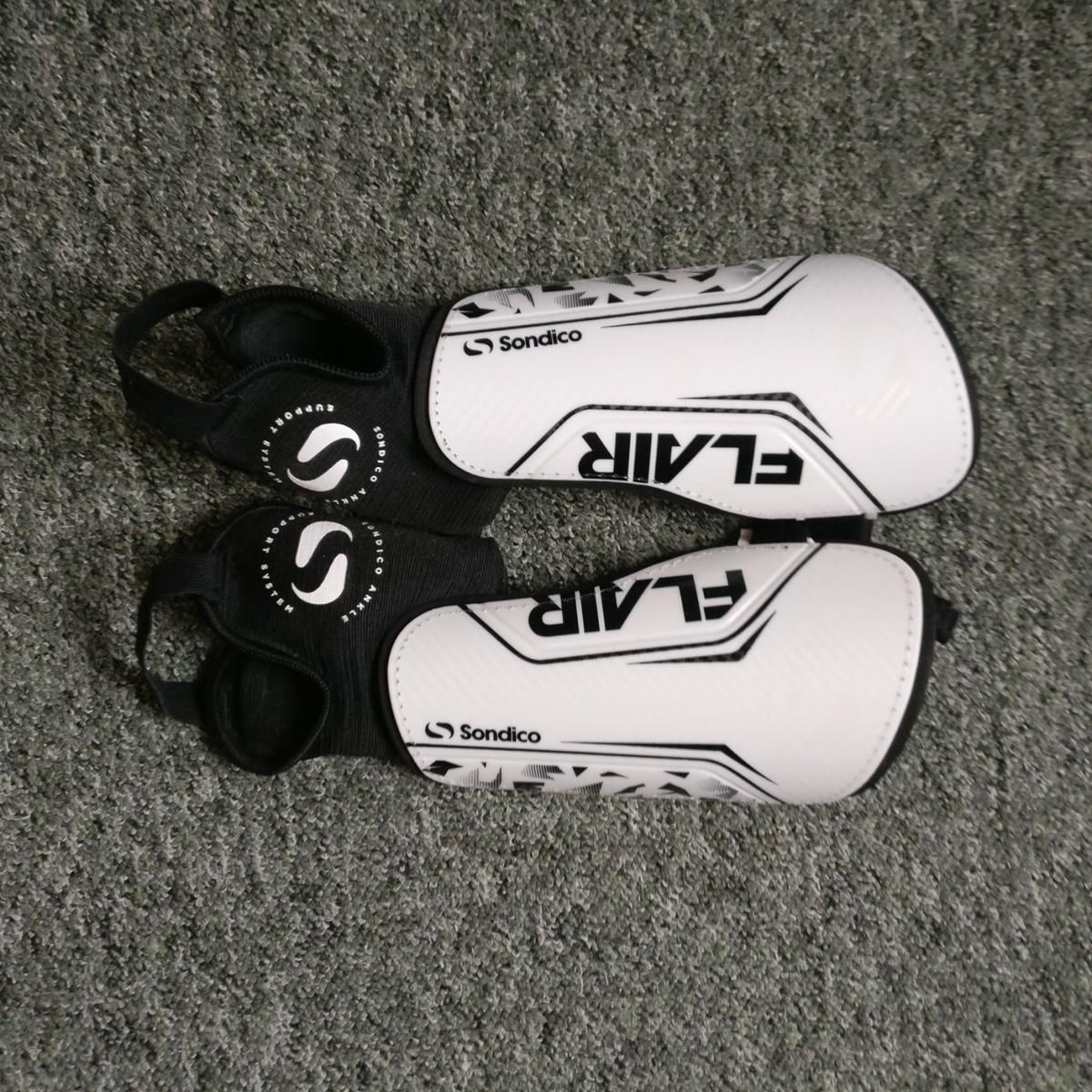 Nike Tiempo football shoes and free shin pads. Very good condition! Size 10 UK.  Used only twice. Amazing football shoes! Will turn any amateur player into a pro! Real bargain.  If you have any questions, let me know :)