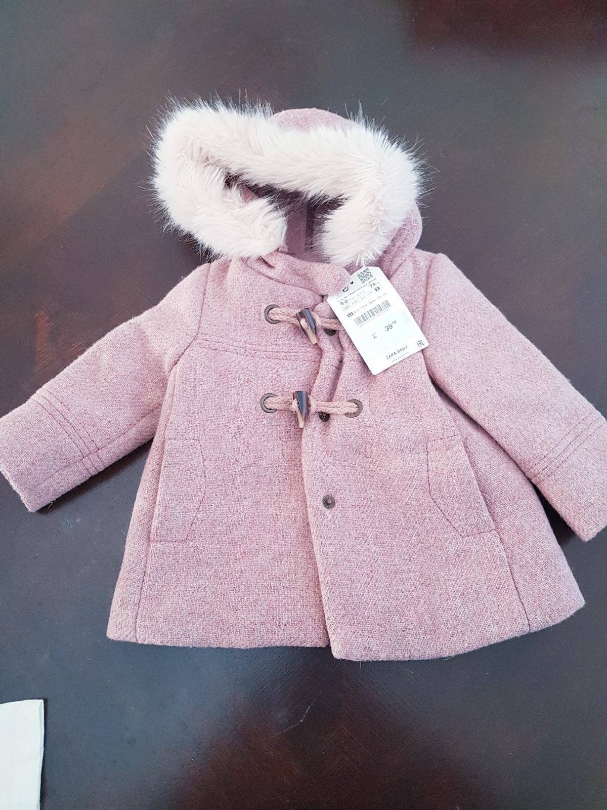 New Zara coat. 6-9 months with tags. no longer required