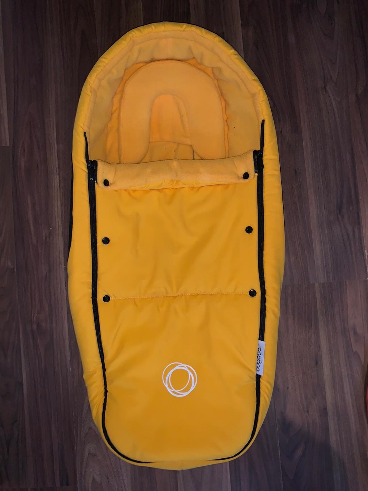 Yellow bugaboo cocoon, only used with one child and Well looked after.