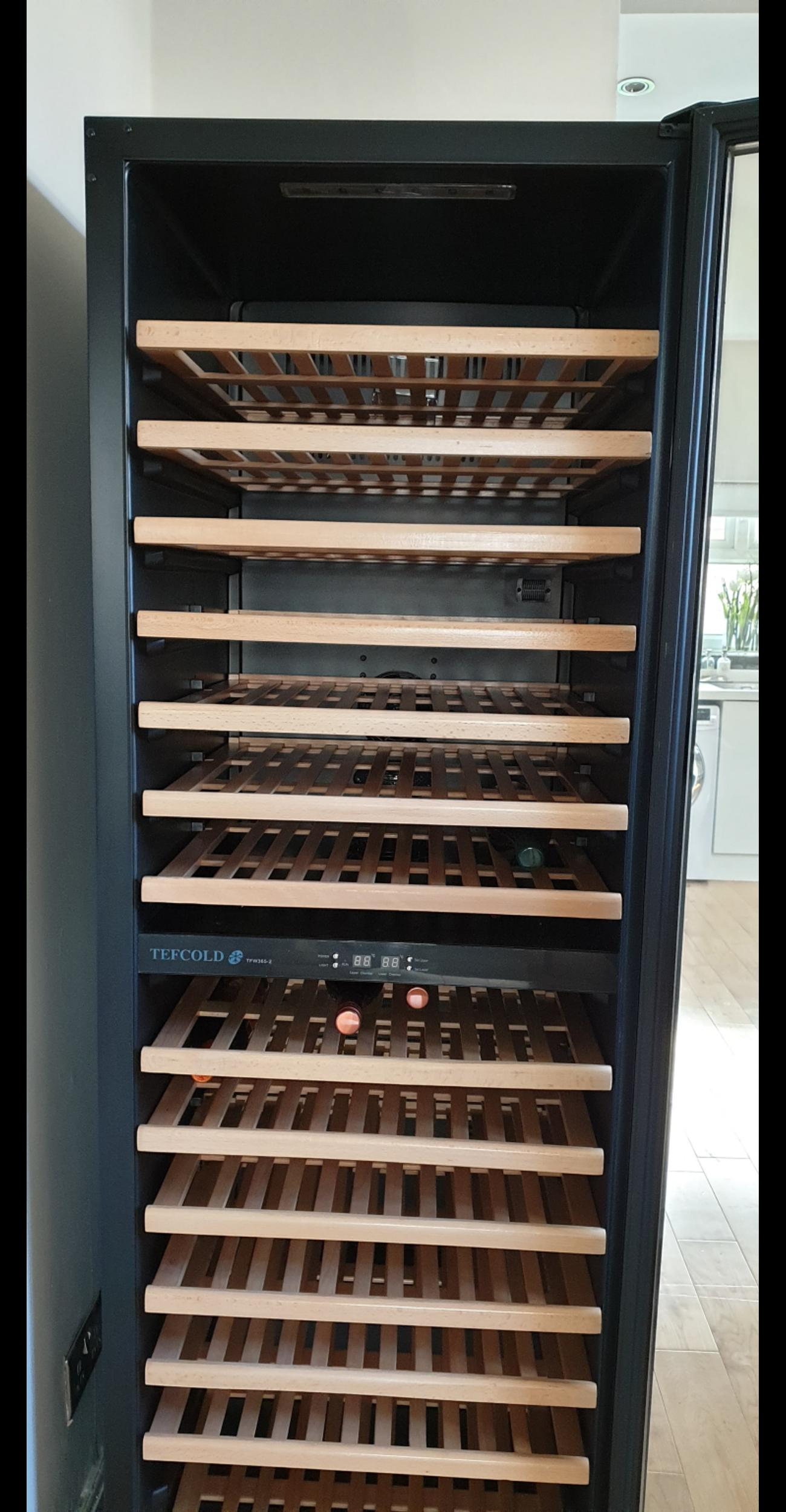 A dual temperature wine cooler. Designed so you can store and display white and red wine at the correct temperature with white wine in the top (up to 77 bottles) and red wine in the bottom (up to 77 bottles). Slide out wooden shelves allow easy selection of wine and LED lights helps to keep energy bills down