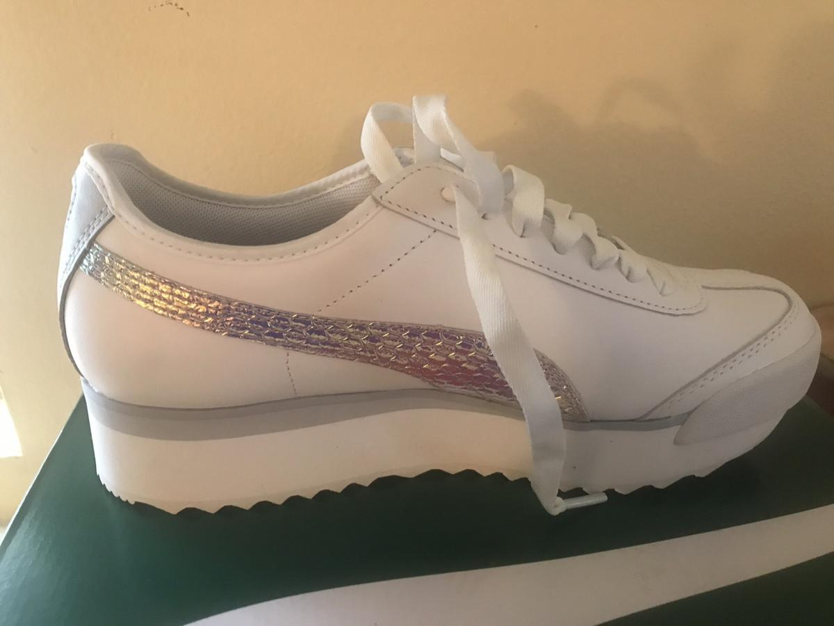 White metallic pumas for ladies! Never worn, got them from Free people. Original price $85, size 8.5