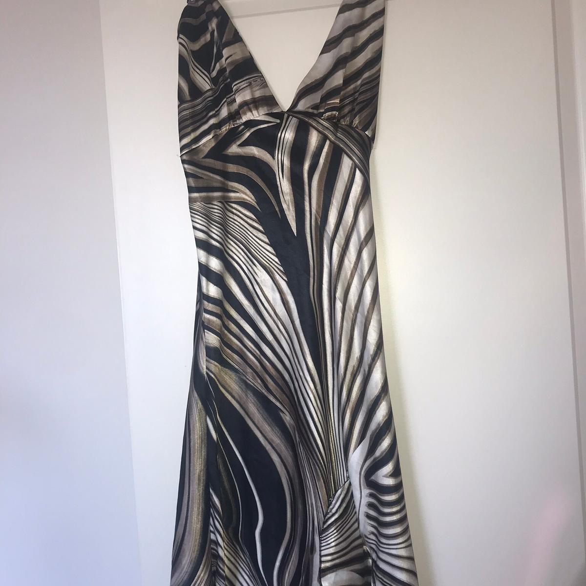 Beautiful Spaghetti strap long dress. NWOT This comes from my personal closet and has only been worn once and that was to photograph. Women's size small