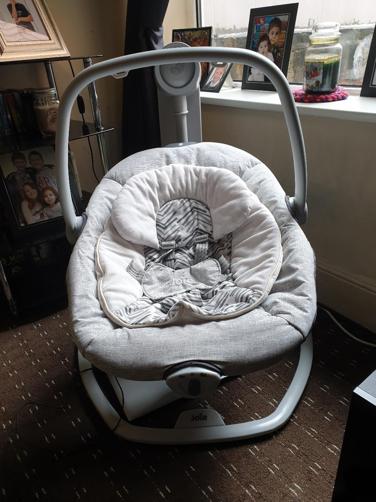 Joie 2in1 baby swing, has various speed settings, music and light. Good clean condition