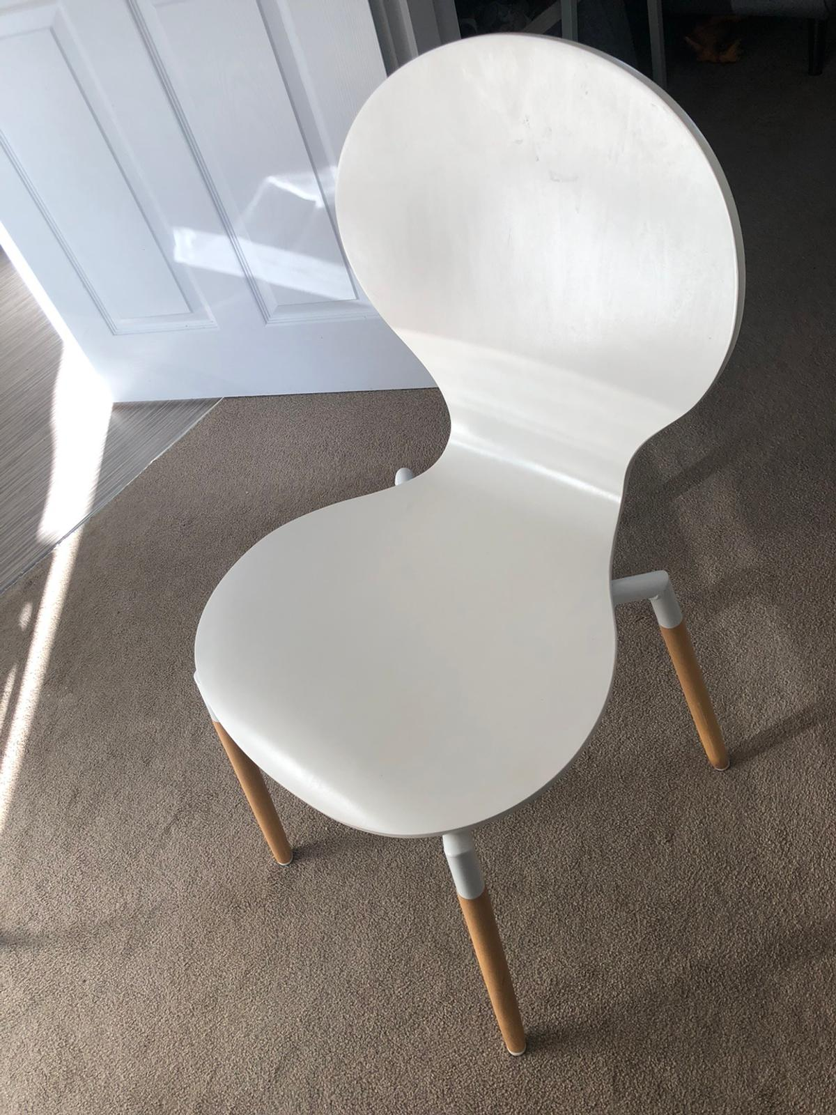 A good,solid dining table in matte white with 4 chairs  Scandinavian style  In overall good condition - perfect for a small space  There are small wear and tear marks - the main being a tiny Nick on the table top (see pic)  L 121cm x W 66cm Feet adjustable for height  Table disassembled for transport - easy to put back together.