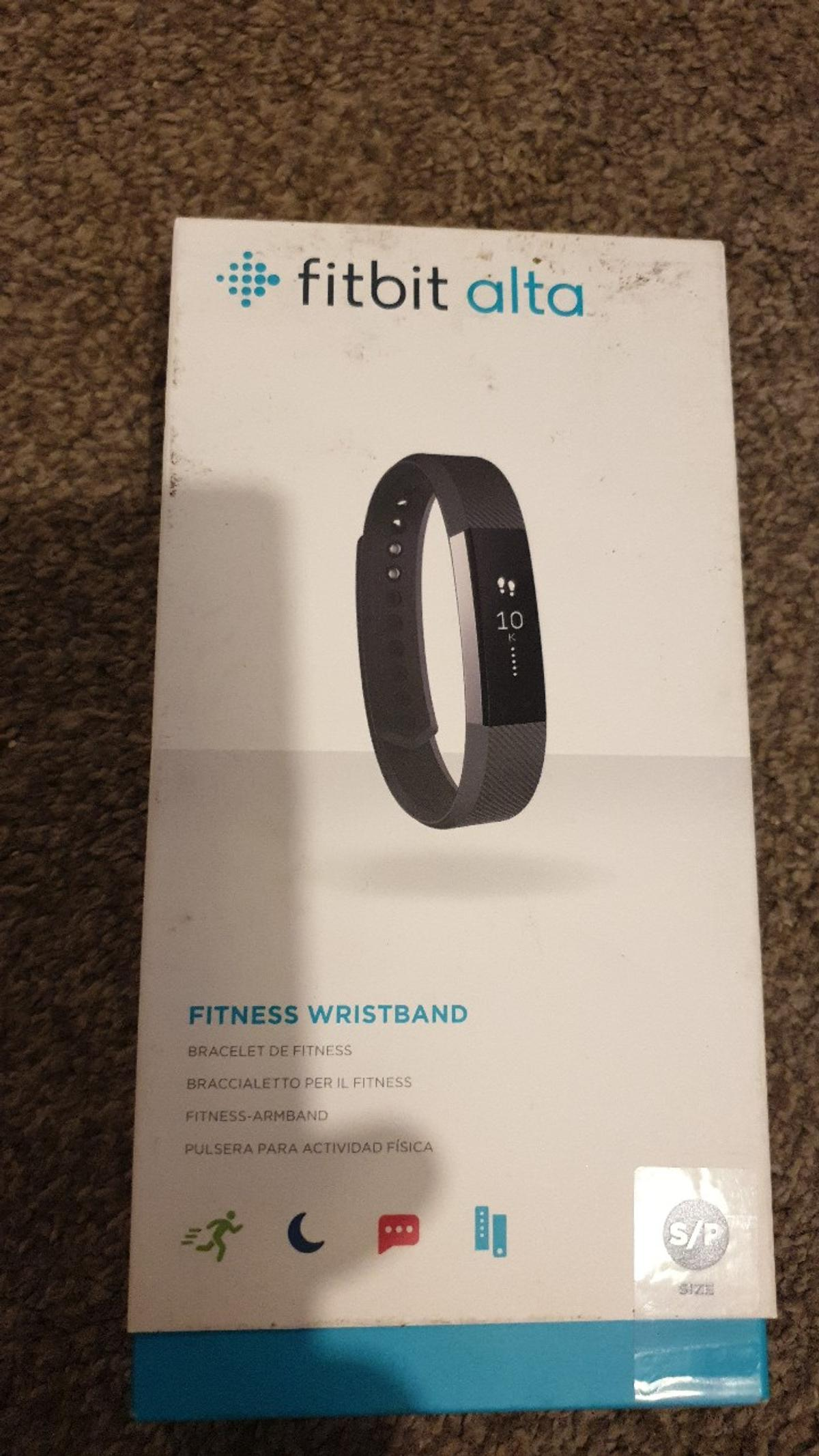 Fitbit alta fitness wristband, item is new and unsealed, never use.