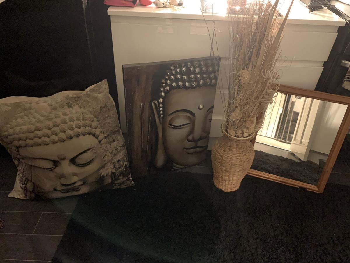 Mirror, vase with twigs, Buddha pillow and picture