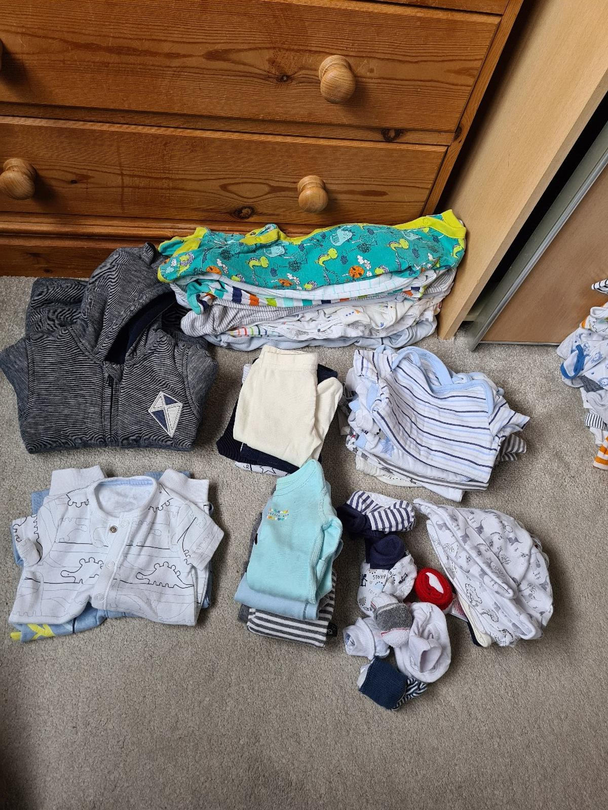 10x sleepsuits 8x tshirt vests 1x pramsuit 5x trousers 4x long sleeved tops 2x short sleeve/leg body suits Mixture of hats/mittens/booties  Collection only from Crowland