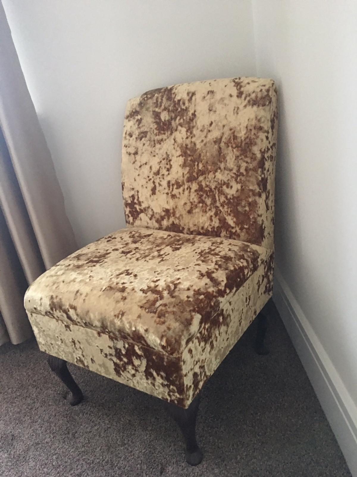 Gorgeous crushed velvet gold chair. Solid wood legs. Perfect unused condition- decorative use only so literally brand new. Cost £150.  Collect from Mexborough please.
