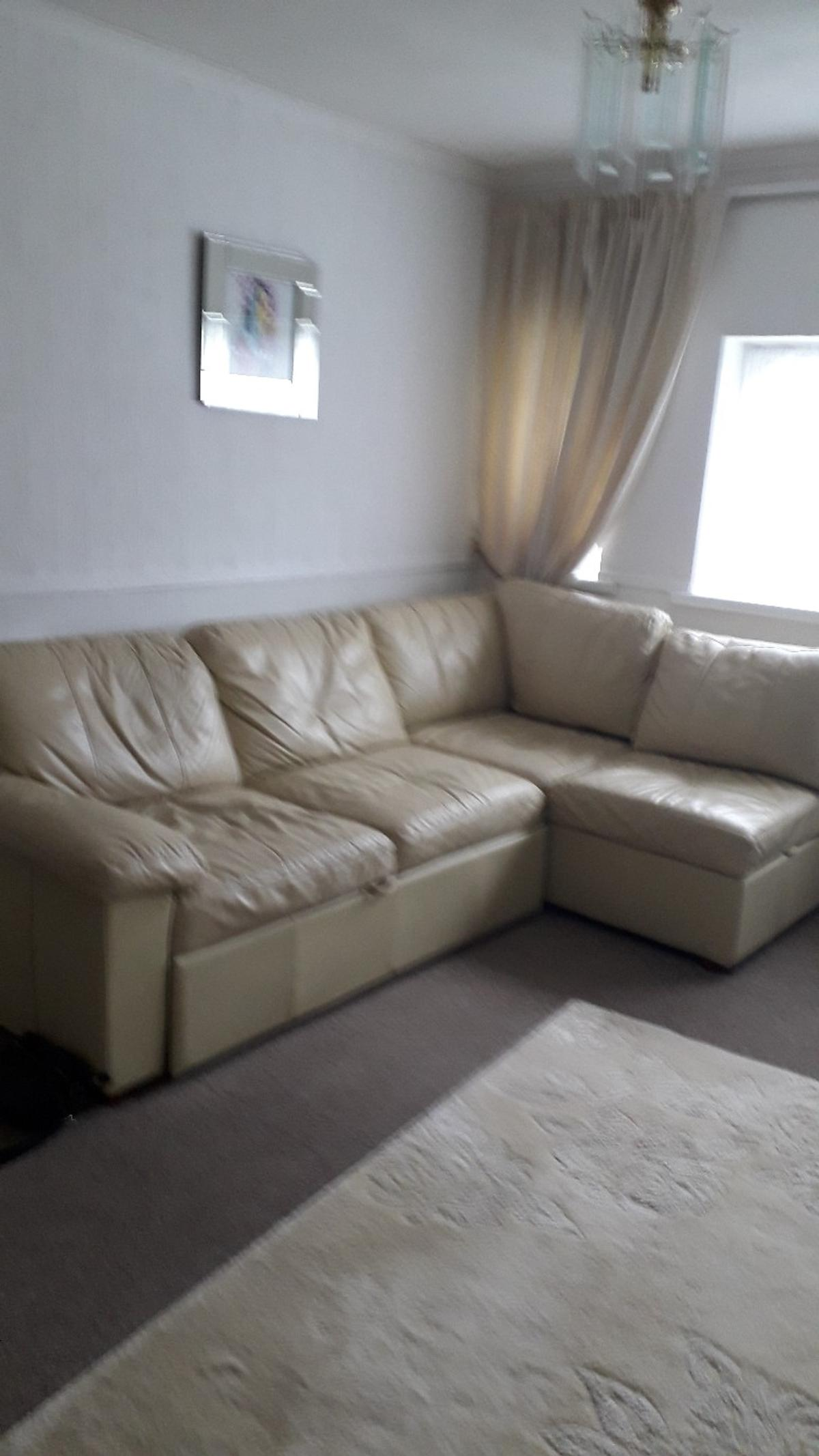 cream leather corner suite with storage and goes into a bed must collect