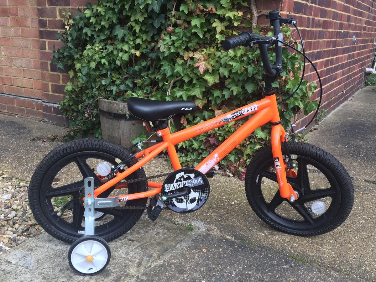 Kids bike with stabilisers includes bell and reflectors.Has only been used 3 times and has been covered (last picture) ever since.  Going for cheap Looking for a quick sale, only very interested buyers. Will be sold very soon so don't hesitate!
