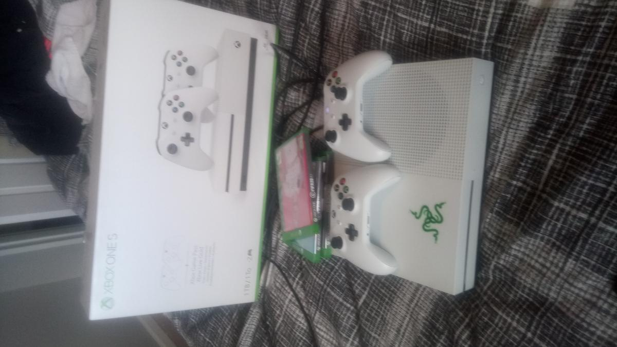 Xbox One S 1TB with cables, 3 games, 2 controllers and 22inch ISIS TV, Open To Offers If you don't want the TV just message me Cables: HDMI, Power Lead Xbox is in Original Packaging 3 Games: fifa 20, fifa 19 and Dishonord Death Of The Outsider
