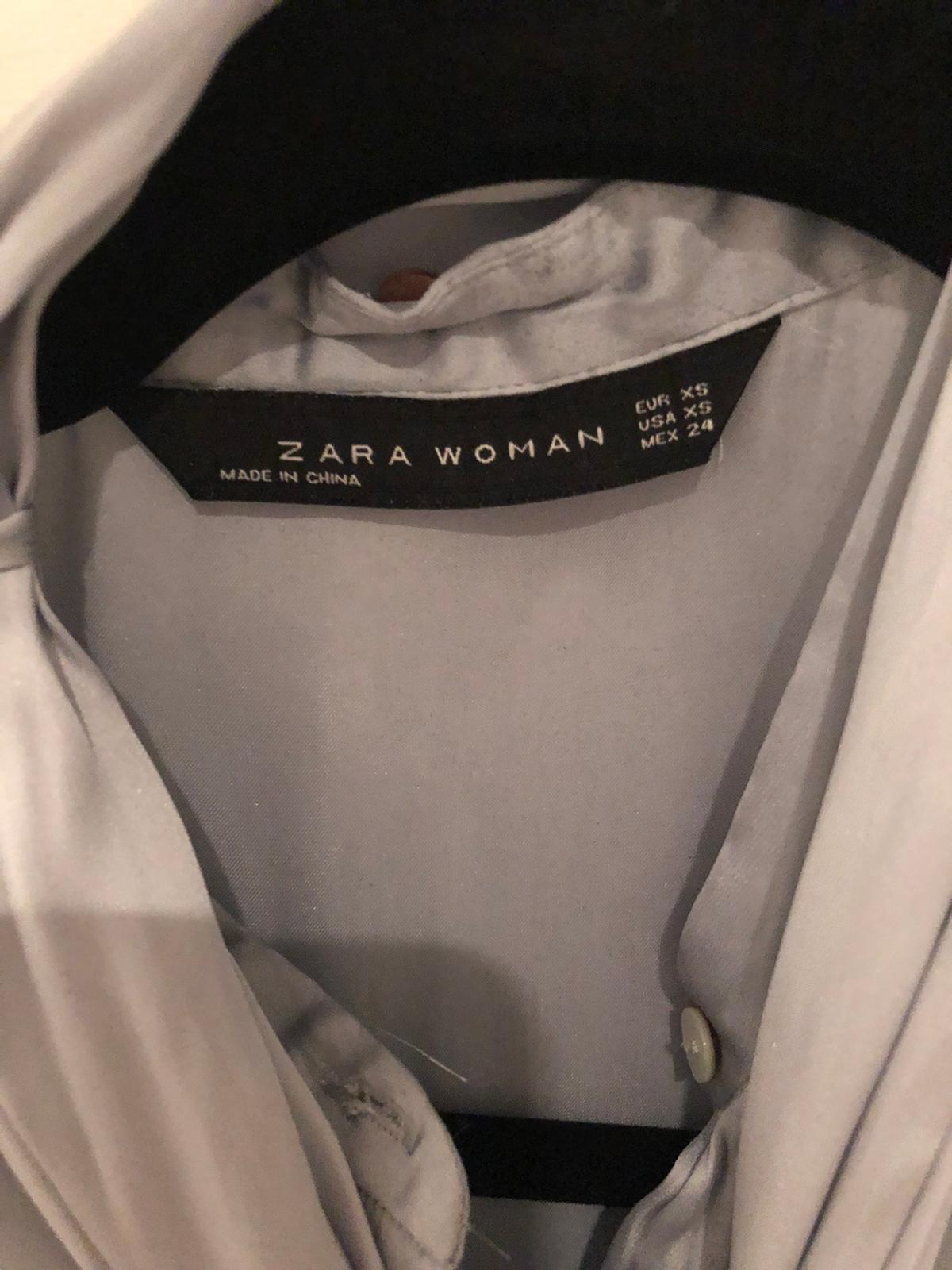 I'm selling here a fabulous ZARA WOMAN light blue shirt with detachable tie/bow. Size XS. In very good condition. Happy to post. Any questions please ask.