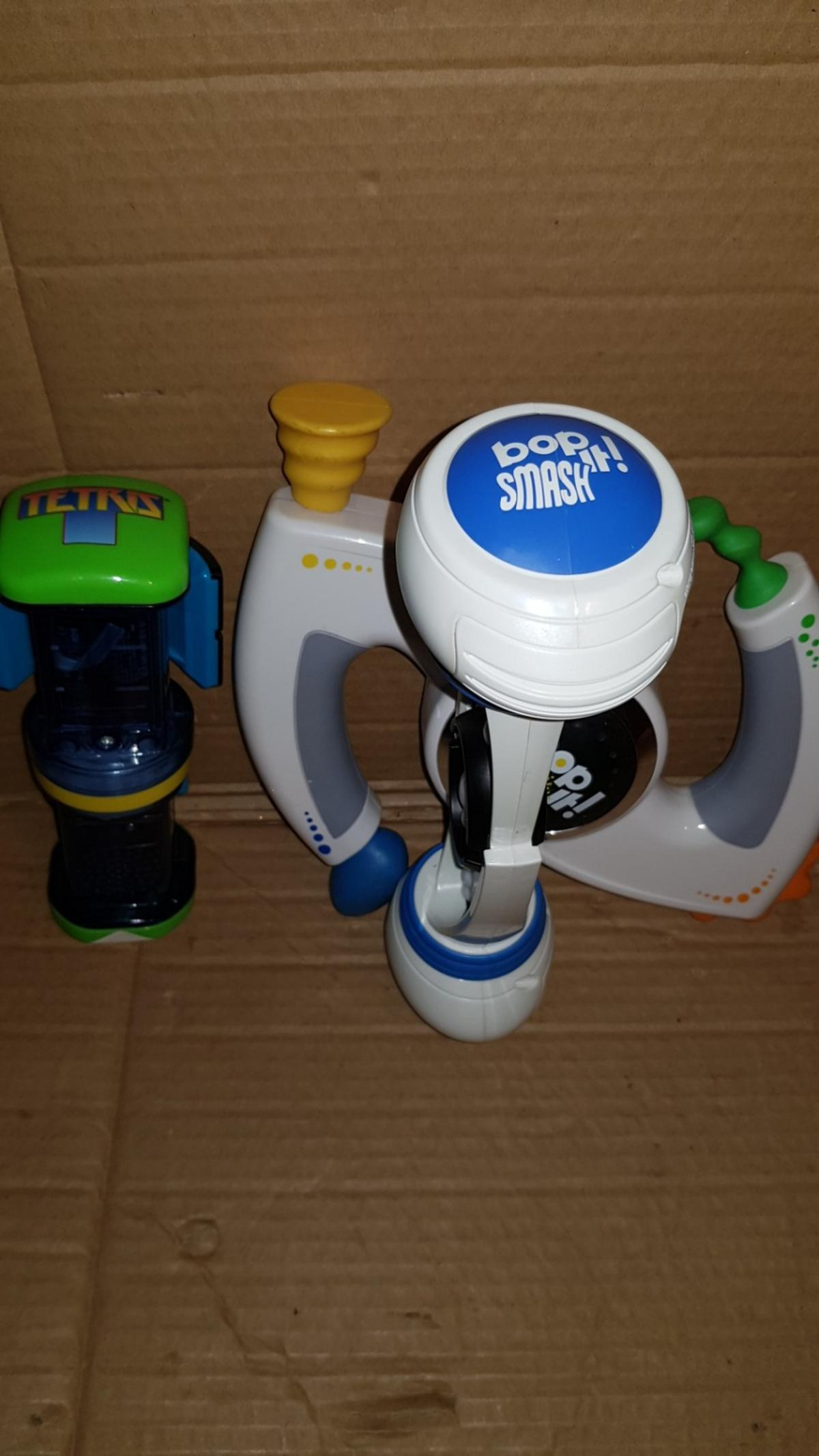THERE ARE THREE BOP IT GAMES BOP IT XT BOP IT SMASH BOP IY TETRIS HOURS OF FUN FOR THE WHOLE FAMILY . NO SILLY OFFERS PLEASE collect or l can post it to you .