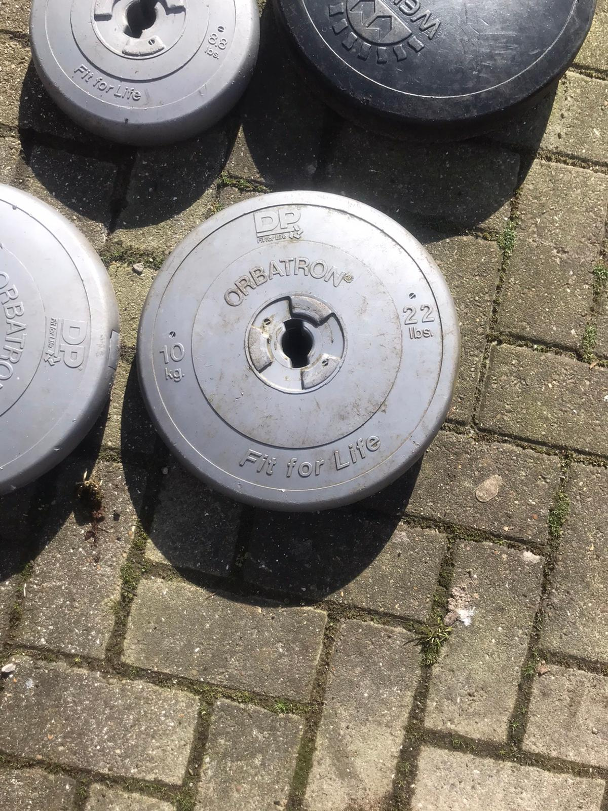 Various gym weights for sale and bar