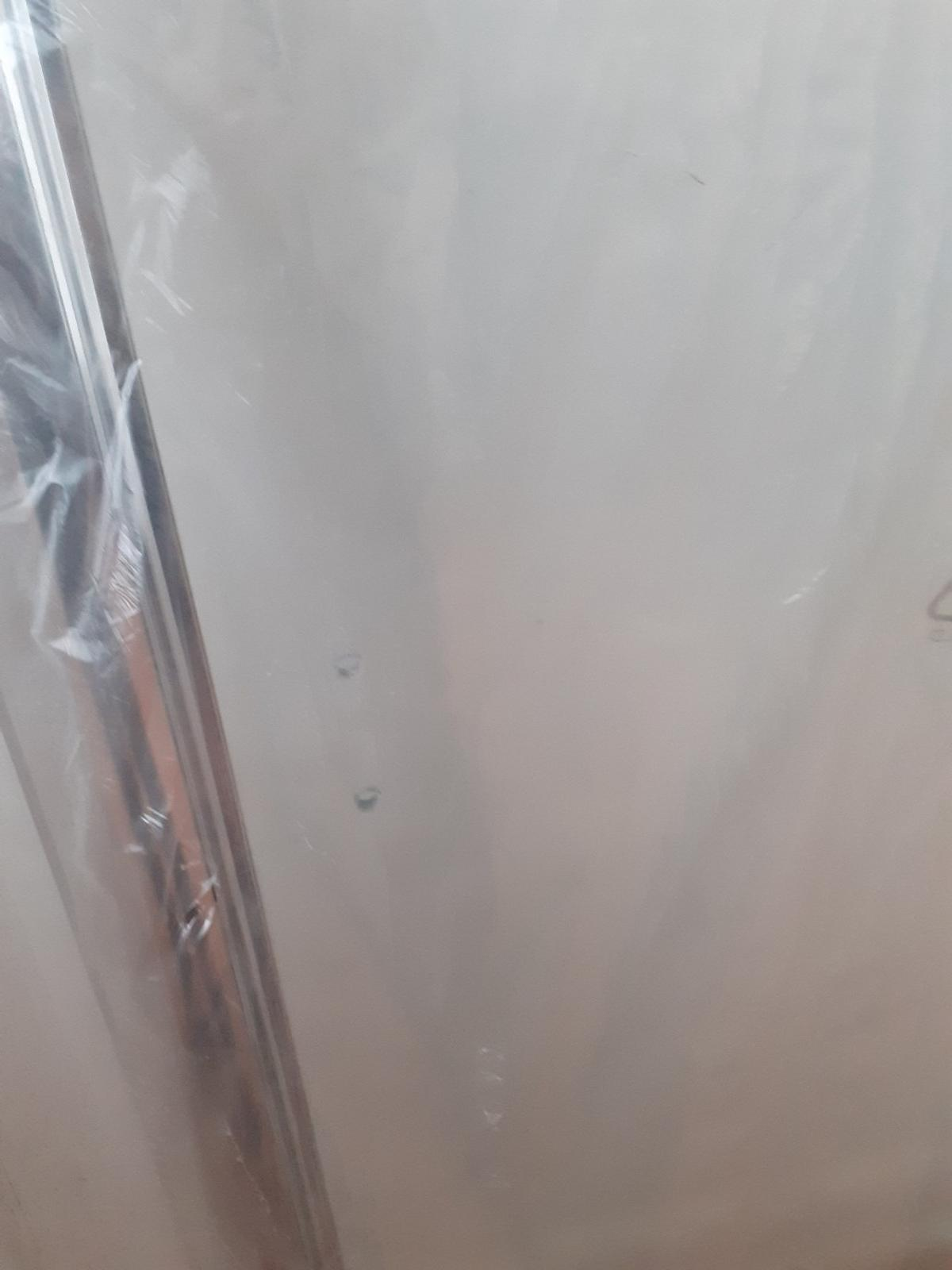 glass shower hinged door in silver frame brand new unused size w 87. h 6 ft ,2 side fixing panel .asking £30 no offers collection only from b23 erdington