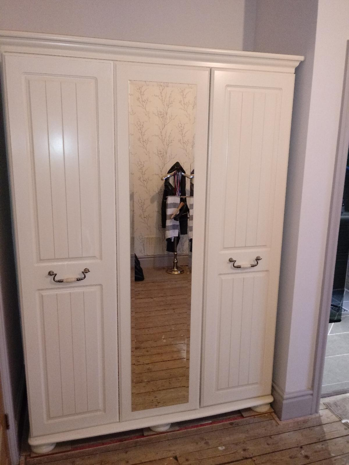 triple wardrobe with mirror in good condition 1400w x1970h x560d. can be taken apart for collection only £125ono
