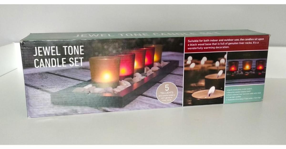 Jewel Tone Candle Set - NEW Suitable for indoor and outdoor use. 5 tea lights with genuine river rocks. 3 available. Collection from M221BU Wythenshawe ( local delivery available )