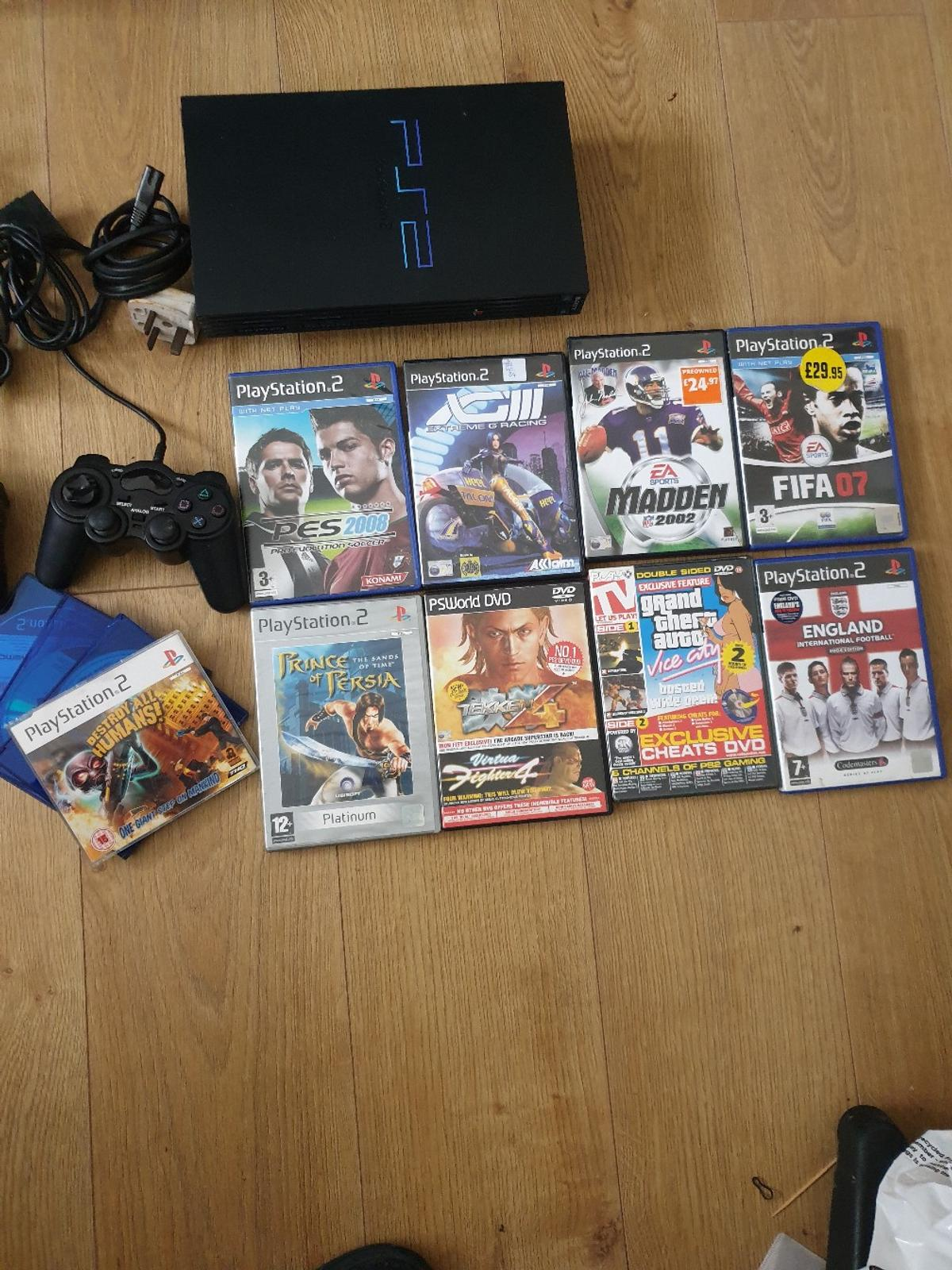 ps2 console with all wires in a excellent condition. Two controllers, and many games.