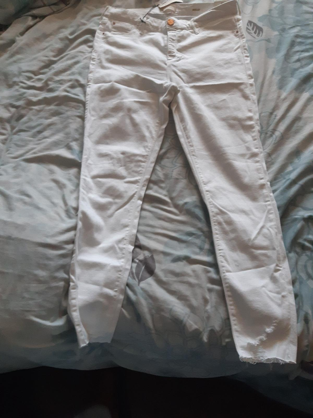 River Island jeans never worn - size 16. ready to be collected or posted at an extra cost.