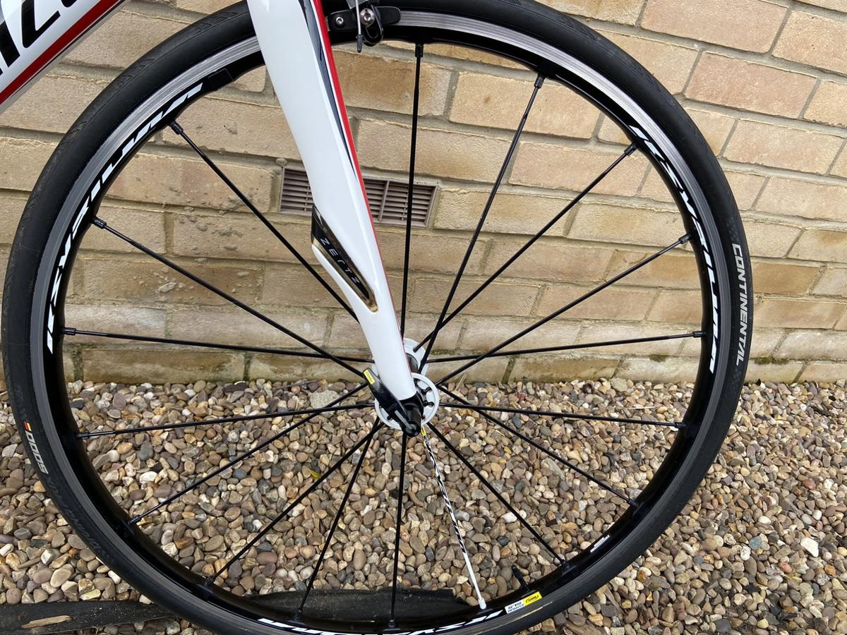Specialized Roubaix sl4, 56cm. **IMMACULATE CONDITION** Purchased for £1000.  Please see below my summer bike for one season. Lots of upgrades including Mavic Ksyrium Wheels which were bought for £800 last year. This bike is in perfect condition. First to see will buy.