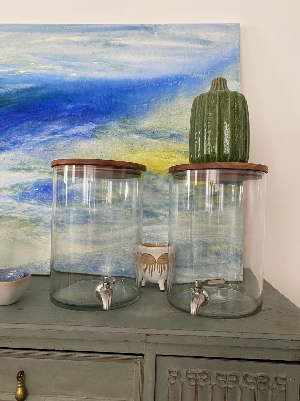 Clear glass drinks dispenser with metal tap and wooden lid - 15.5 cm diameter, 24cm height. Can contain 4 litres.  Used once for our wedding. Price is per unit. 2 to sell.