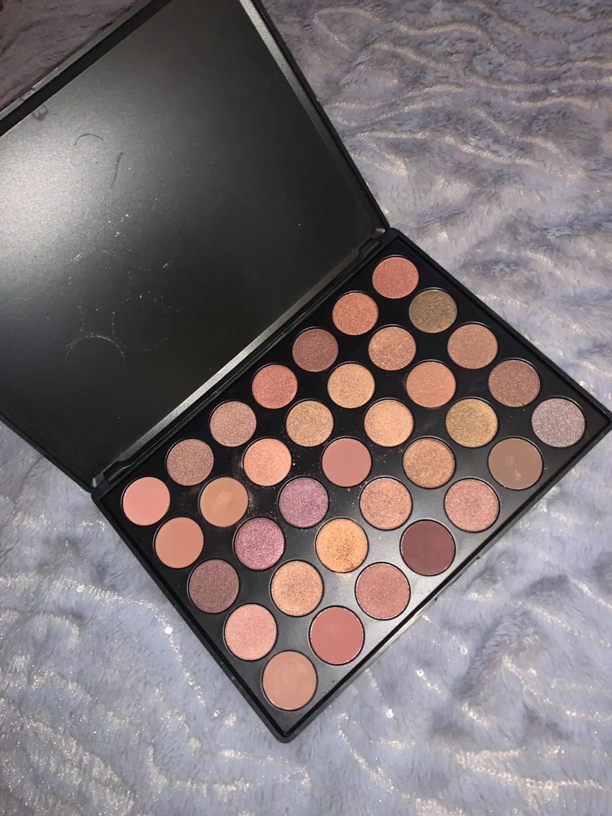 Used but not much! Can hardly tell it's been used all eyeshadows have a lot of use in it, only selling as I don't wear eyeshadow much! Open to offers
