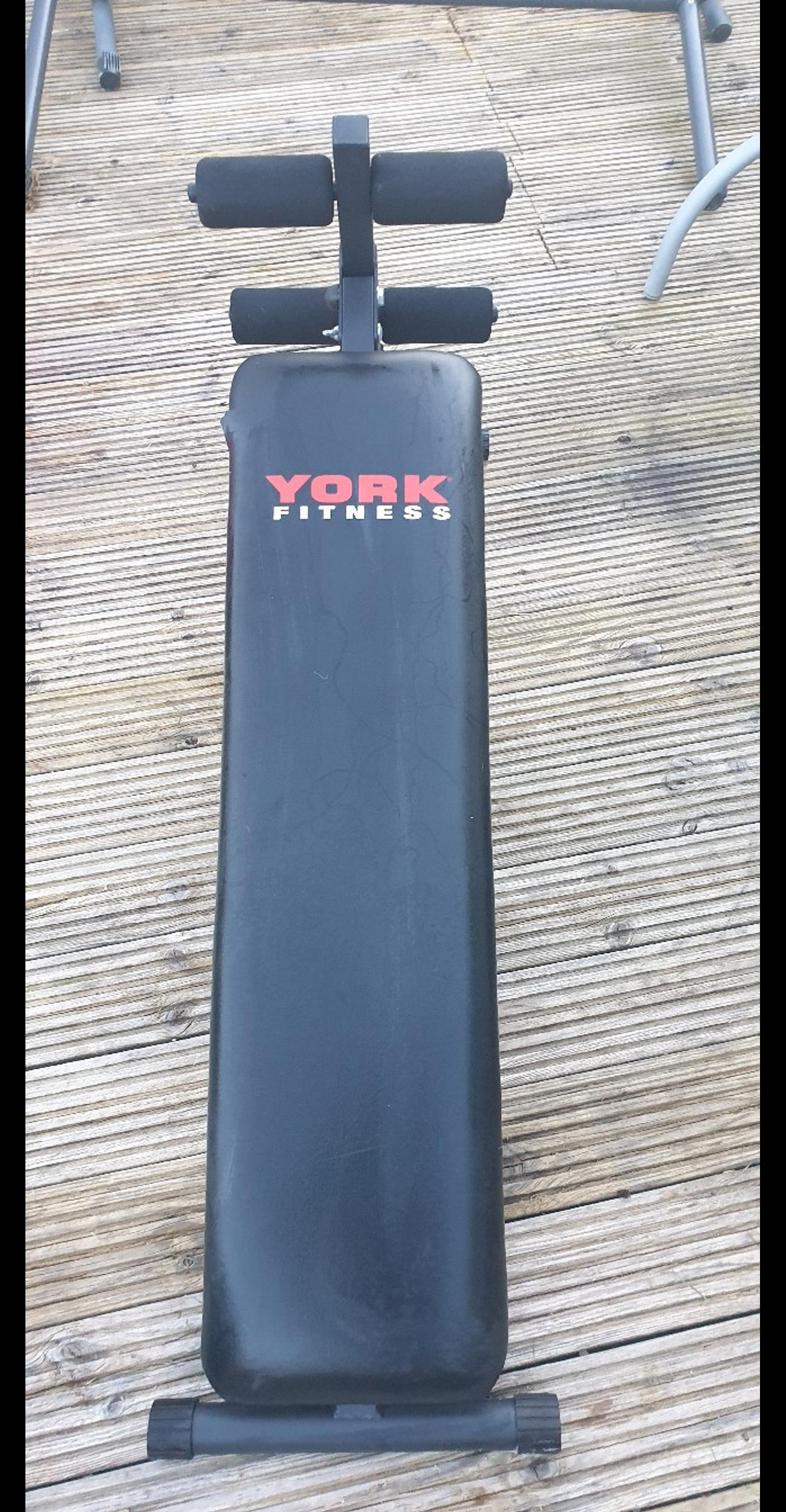 York Fitness Barbell Abdo Board. Adjustable Incline and Leg pads. Has a slight tear on the side but doesn't affect it in anyway. Been sat in shed for a while so could do with a clean. I have given it a quick wipe down.  Collection only