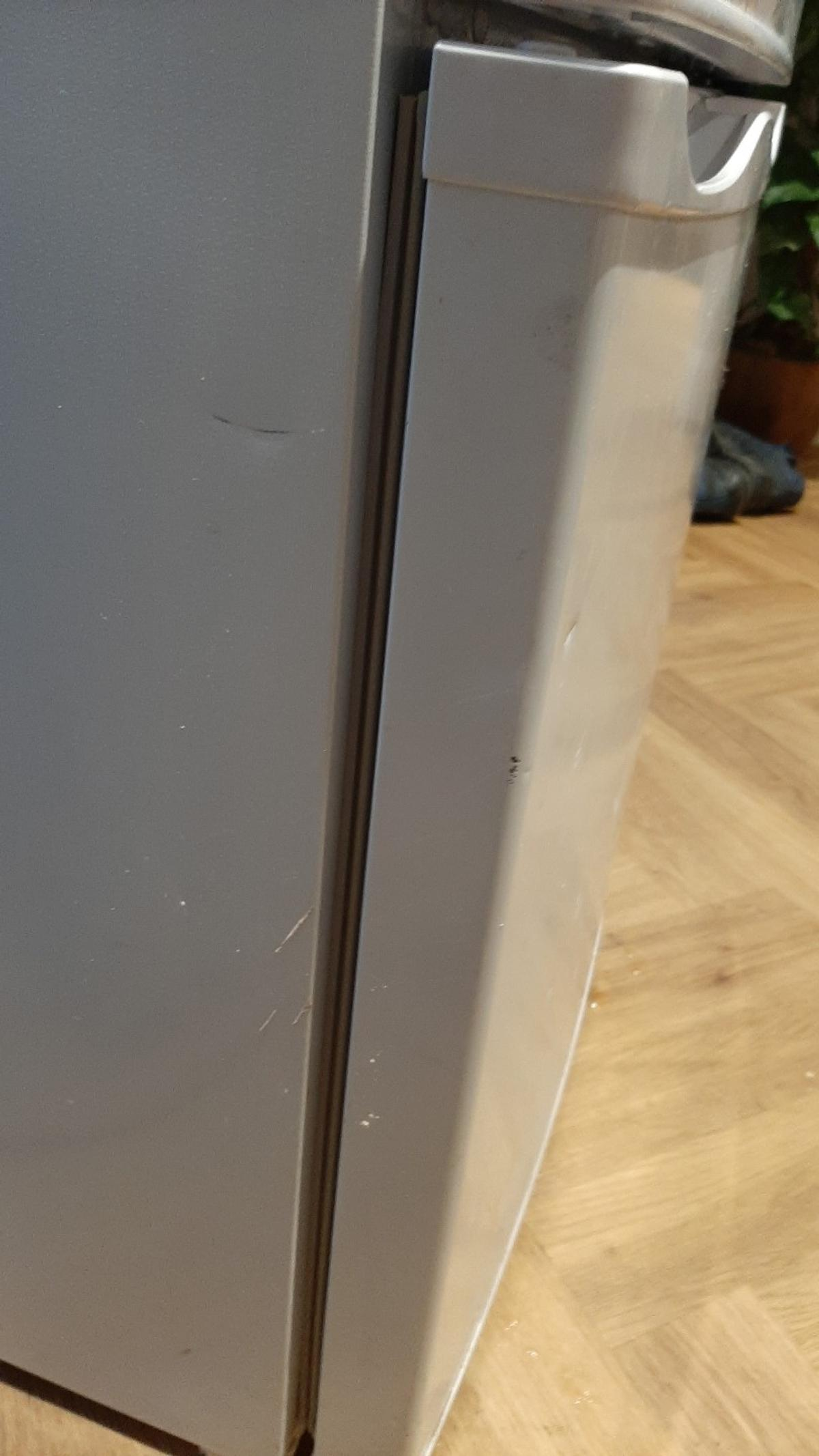 fridge freezer, 3 shelves and veg compartment, 3 freezer draws. 141 cm height by 49cm wide. few dents in bottom front door. bottom door needs to be closed firmly but it does seal if done so.