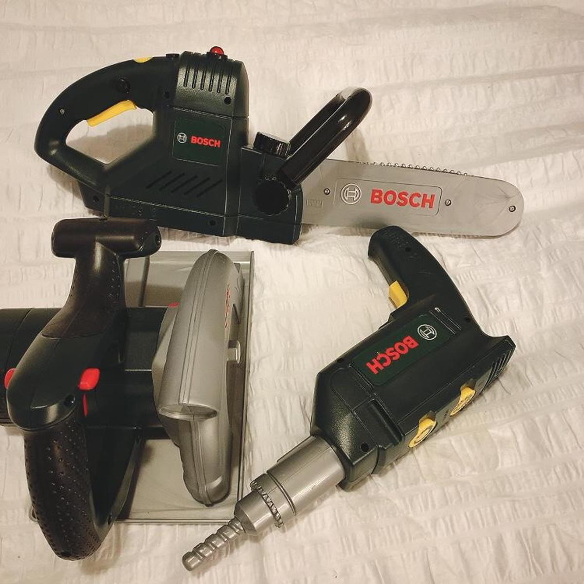 Virtually brand new, set of 3 kids Bosch toys, work on batteries and make noises. Drill, chainsaw and circular saw