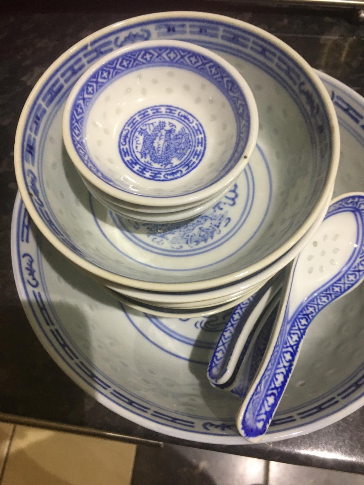 Just like new, with a large soup bowl, 5 small serving bowls with 4 chatney miniature bowls and matching 4 soup spoons