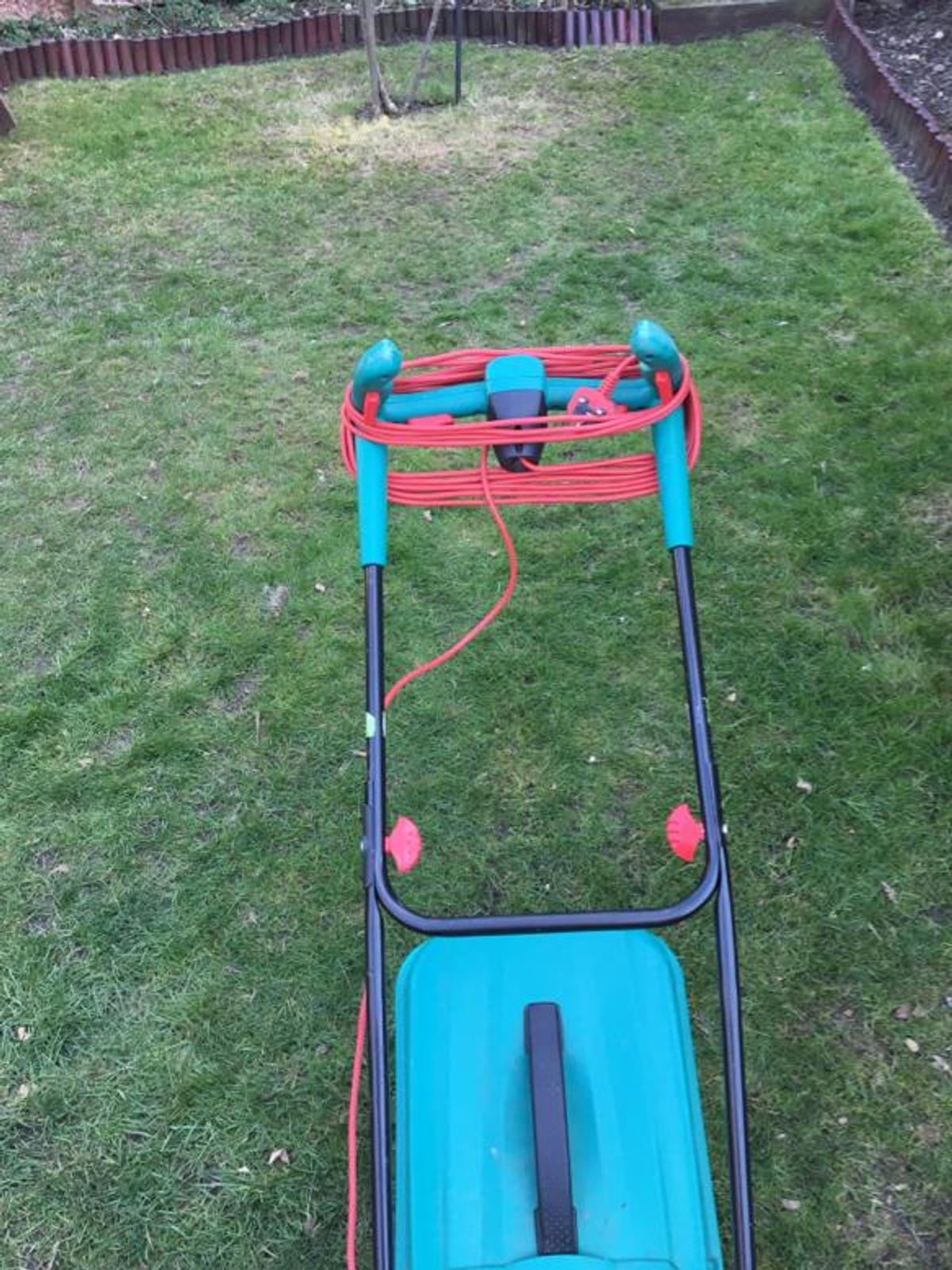 Bosch electric mower in good working order. Easy to adjust height, light, perfect for medium size garden. Cable has been taped in one point as been catch by the handle when folded. Hasn't been snapped, but taped for extra safe. Blade sharpened. Back roller for perfect stripes.