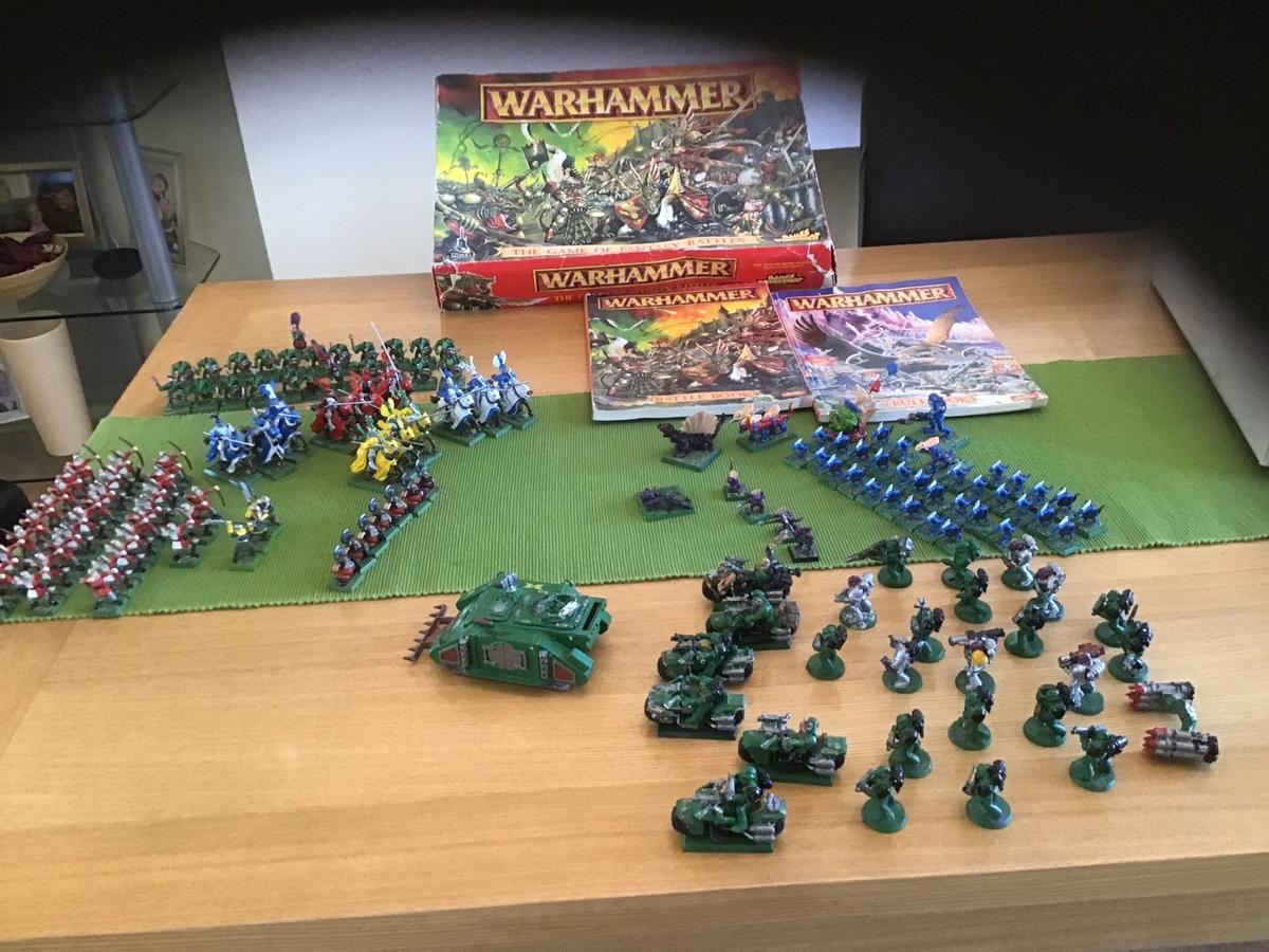 Selection of Warhammer figures and books from Games Workshop.