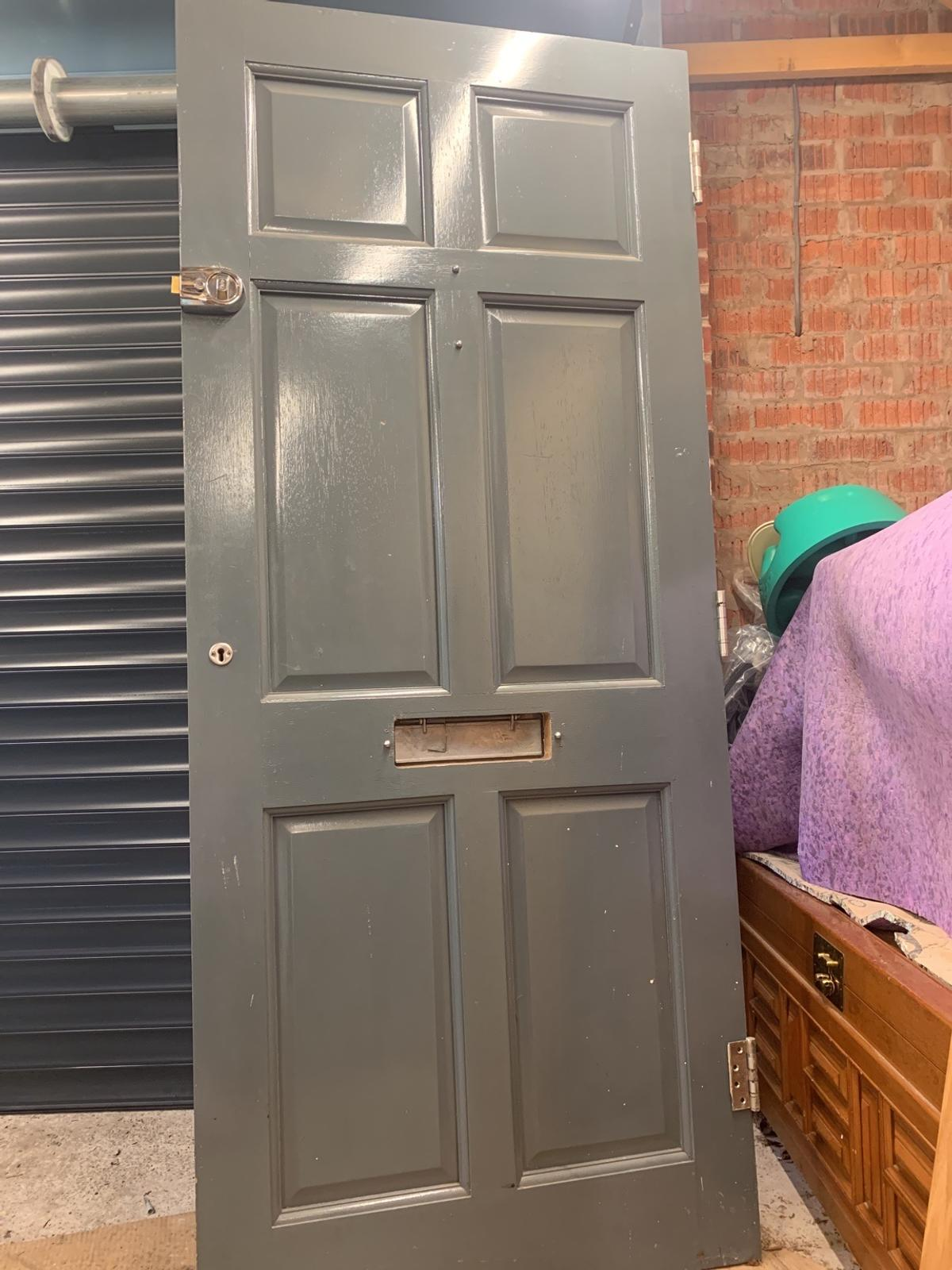 197cm tall, 84cm wide and 4.5cm thick.  Comes with silver door plate and post box plate, hinges, door knocker & lock and key.  Collection only