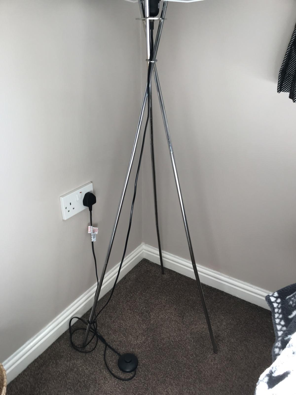 Black velvet circular shade with Crome affect tripod legs. Click switch and long cable. Nearly new, hardly used but due to moving and down sizing I need to get rid of it