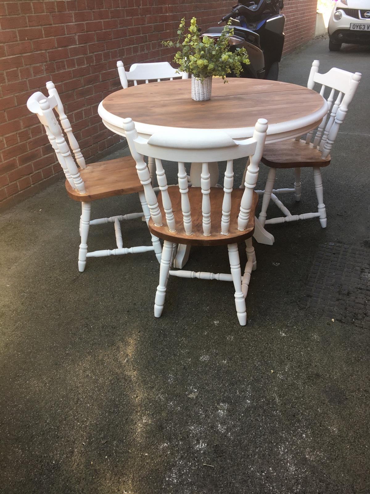 Shabby chic table and chairs in white with natural wood on top and on chairs solid table in excellent condition grab a bargain