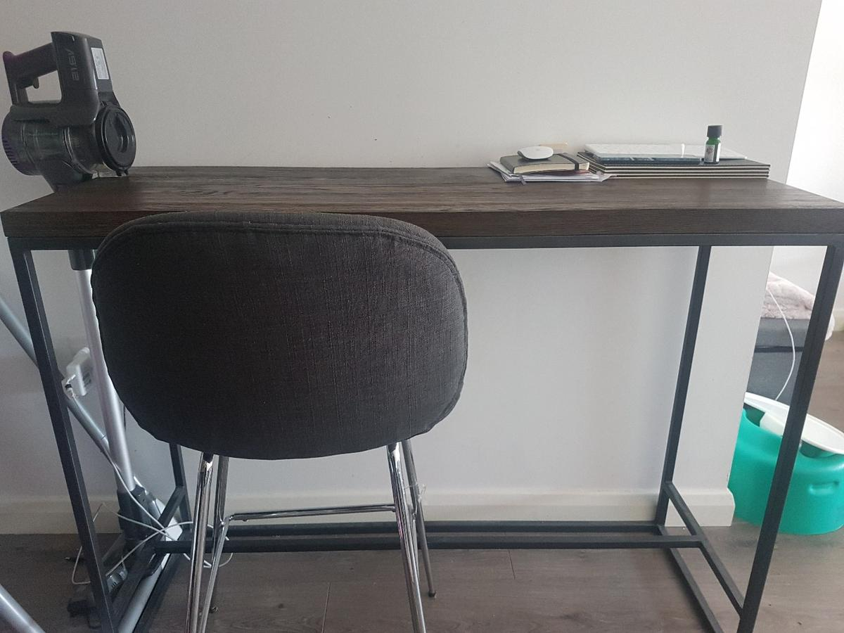 John Lewis bar table. like new condition, only had for 5 month, never used it.  I'm moving house and need it gone. chair comes with it.  paid £230, wanting £160 price not nagociable.  colour - walnut H-90cm W-120cm D-45cm  weight 22kg  fully assembled, can't be dismantled  Can either COLLECT, or I can ARRANGE a courier to deliver to you. However that will cost extra. happy to cover half the delivery charge.  the stool also comes with the table.  ITEMS ON THE TABLE NOT INCLUDED.