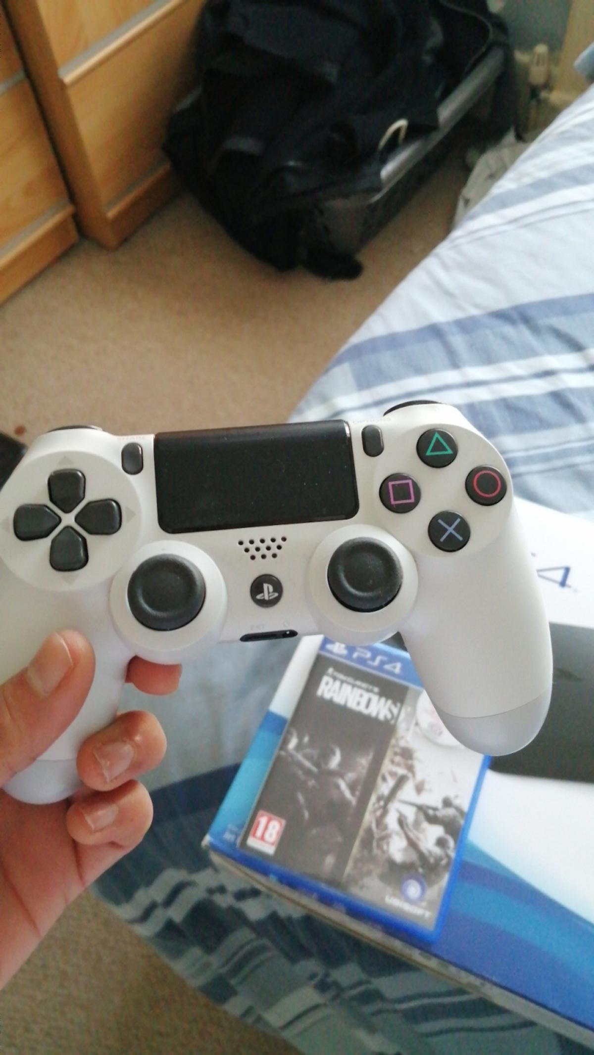 Mint condition used handful of times fully reset and ready to go. comes with all leads brand new and unused, white controller slightly used and a copy of rainbow six siege.