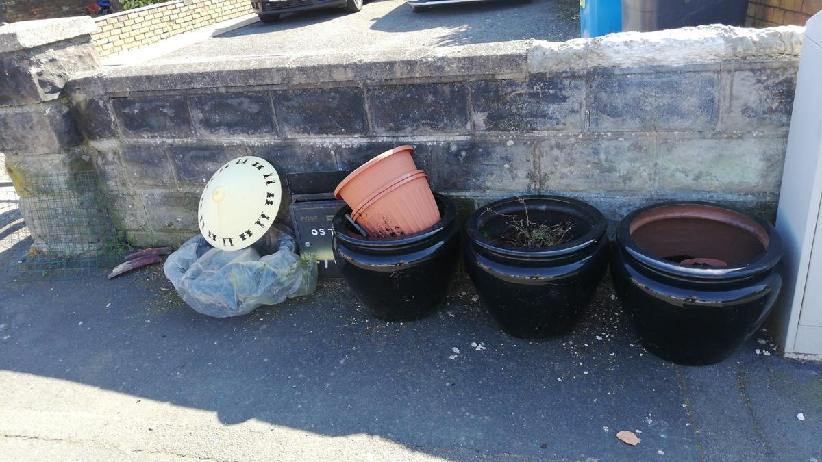 large plant pots about one and half feet with soil free to collect