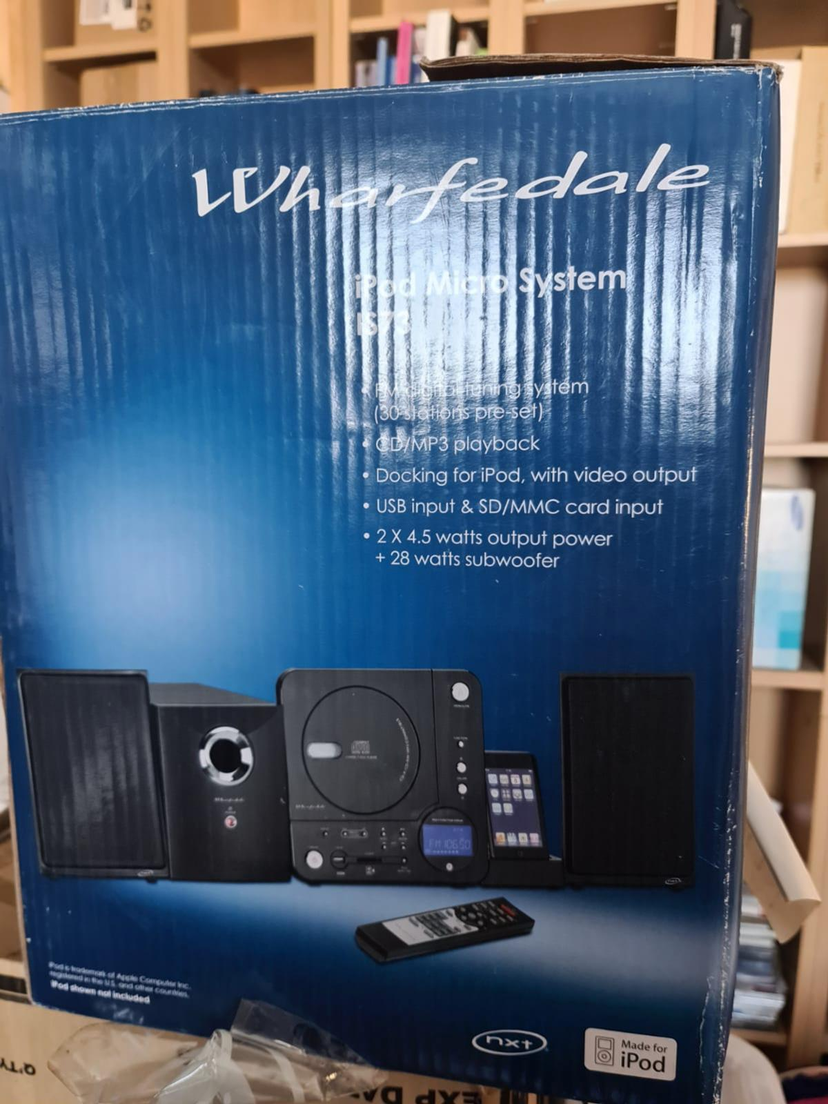 good condition stereo system with cd player and ipod docking station in original box. collection only