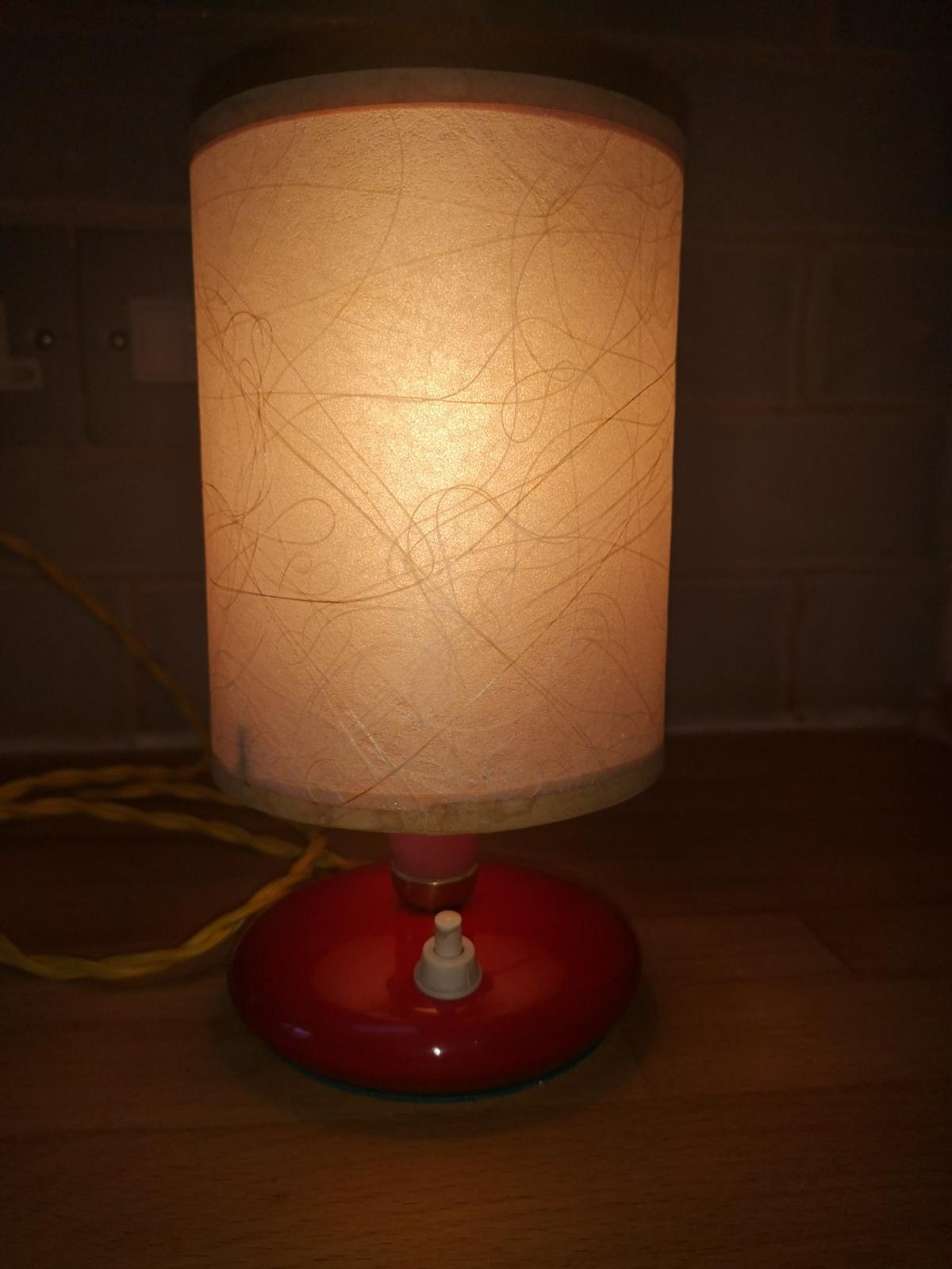 """This is just a little stunner. Mid century Italian lamp. Cast aluminium base with a red paint coating and paper shade. Rewired in yellow vintage cable.  At just 8"""" tall and 4"""" diameter it will fit just about anywhere. PAT tested this morning. £45.00+p&p"""