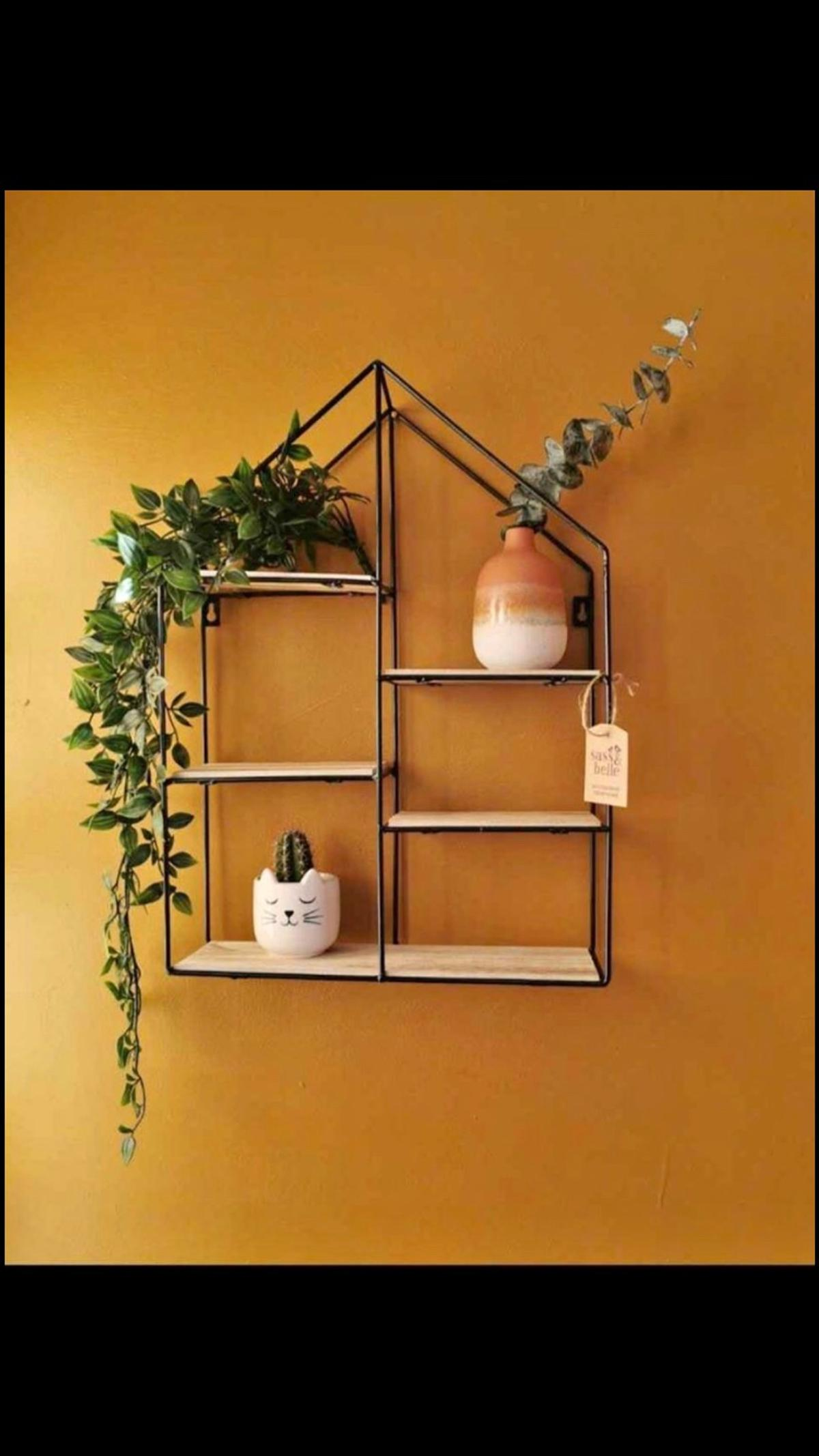 Featuring two handy hook openings and six platforms to decorate or leave minimal. We think it would look super cute displaying your favourite plants, photos or any other pretty trinkets. Product codeZHA003 Barcode5055992767474 CollectionHome Essentials ColourBlack DimensionsL35 x W10 x H48 cm MaterialWire, Wood