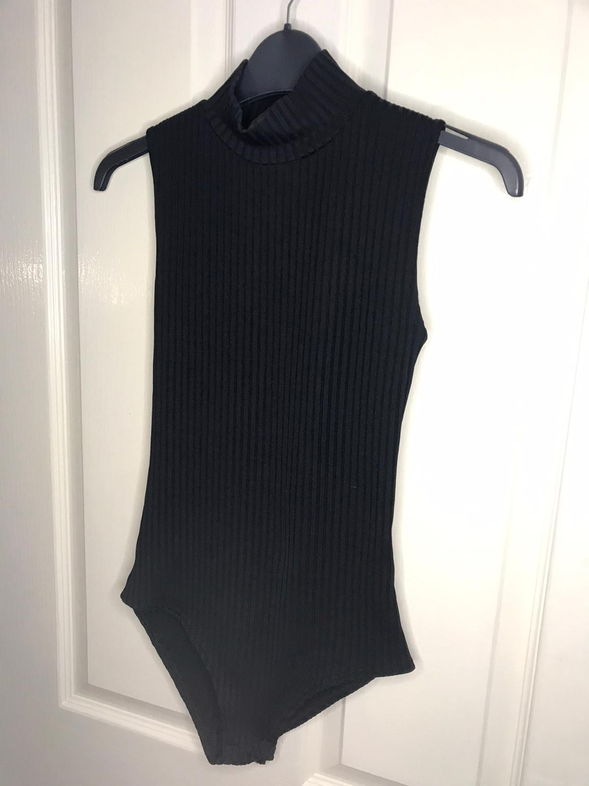 Size 8 black bodysuit with ribbed pattern