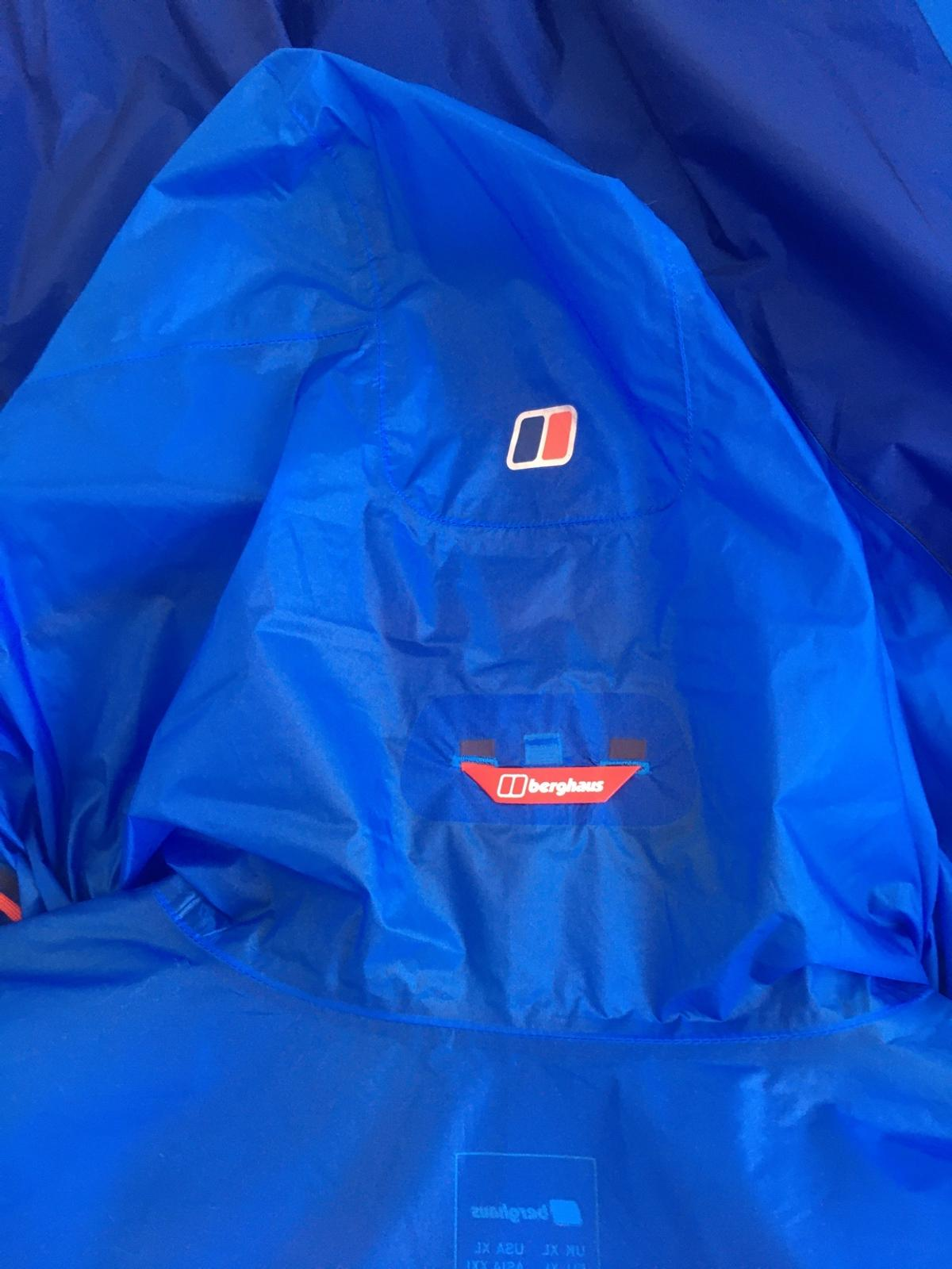 Worn once light wait jacket sizeXL blue whit red strip on cuffs bottom and on zips has to zips one is a pocket shown on pic logs on hood has Antigua design and development on zip partoff a key spout light on bottom off let side Hyde shell hyper on bottom of right arm like new