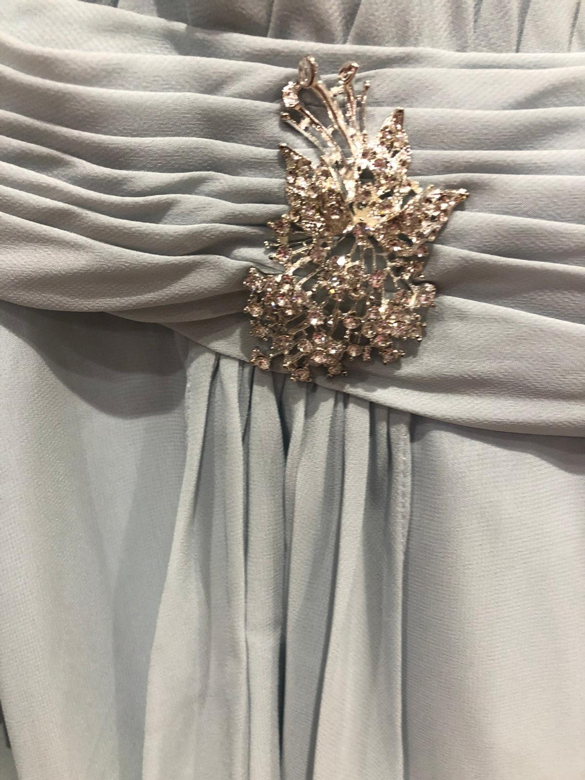 Brand new with tag size and colour shown on label photo. Comes complete with matching long chiffon jacket. Bargain price Original price is £115+ £20 shipping Selling at a bargain price